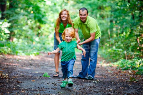 Portre mutlu aile park açık atış gülümseme Stok fotoğraf © luckyraccoon