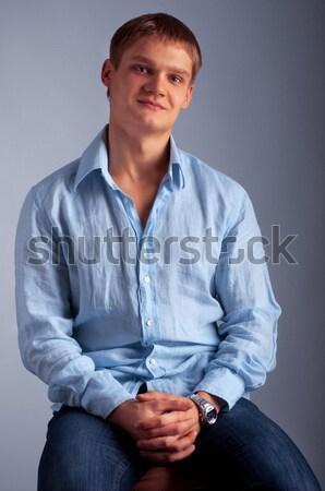 Сток-фото: молодым · человеком · глядя · портрет · молодые · улыбаясь