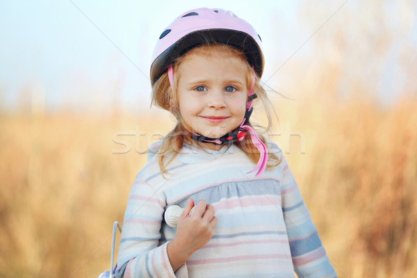 Small funny kid with bike posing. Stock photo © luckyraccoon
