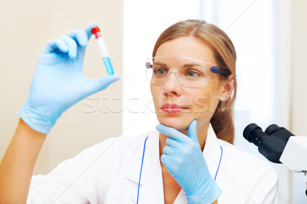 Young scientist working with samples in lab. Stock photo © luckyraccoon