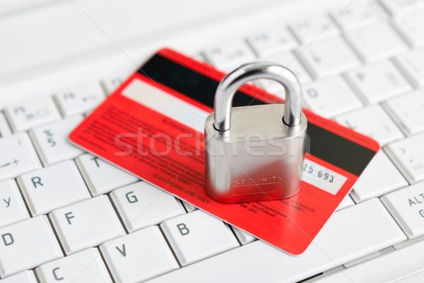 Credit Card and padlock on keyboard. Stock photo © luckyraccoon