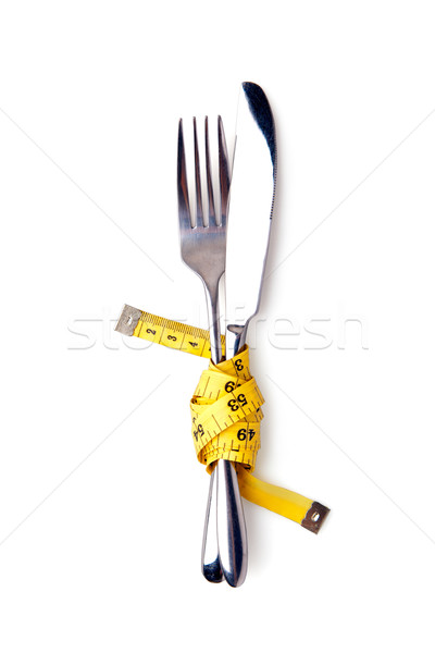 Measuring tape on a fork and knife concept  Stock photo © luckyraccoon
