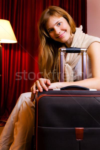 Gülen genç kadın oturma otel odası iş mutlu Stok fotoğraf © luckyraccoon
