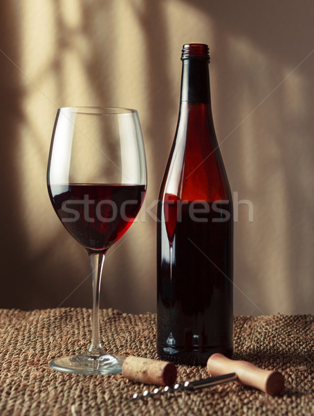 Bottle and glass of red wine Stock photo © luckyraccoon