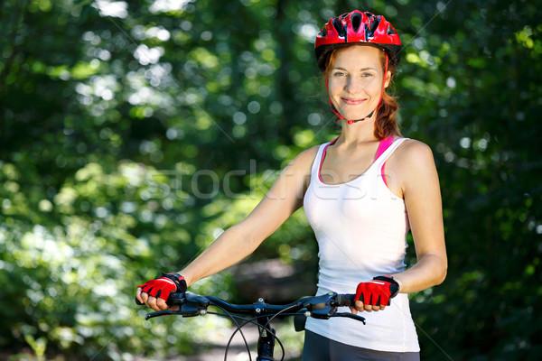 Portré boldog fiatal nő hegyi kerékpár kint természet Stock fotó © luckyraccoon
