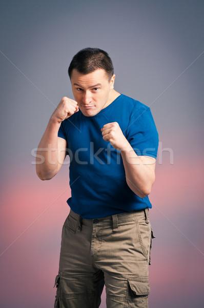 Fotoğraf genç ayakta boks pozisyon adam Stok fotoğraf © luckyraccoon