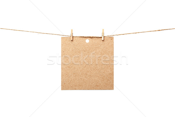 Old sheet of paper hanging  Stock photo © luckyraccoon