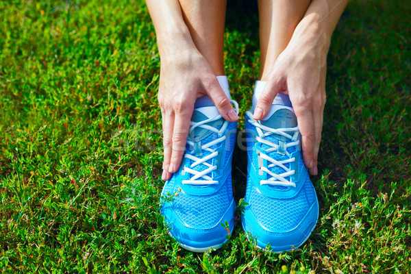 Stock photo: Running shoes on grass - concept image