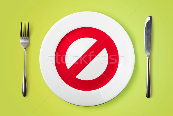 Empty plate with restricted red sign on it  - dieting concept im Stock photo © luckyraccoon