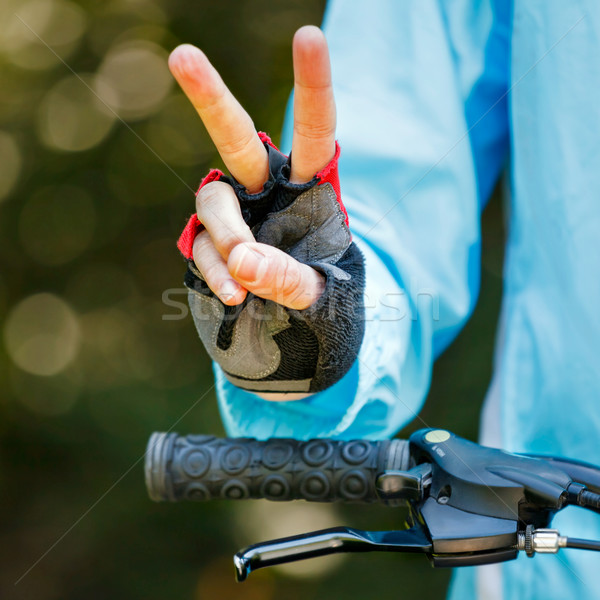 Biker showing victory sign - cycling concept image Stock photo © luckyraccoon