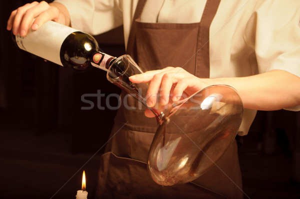 Sommelier pouring red wine Stock photo © luckyraccoon