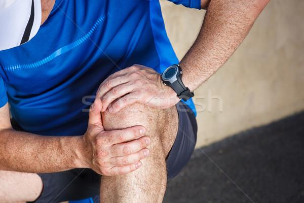 Mannelijke runner problemen knie gezamenlijk weg Stockfoto © luckyraccoon