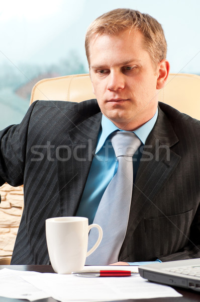 portrait of a young businessman in doubt about something Stock photo © luckyraccoon