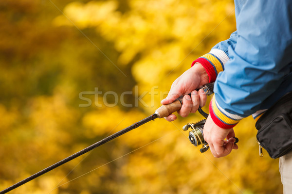 Fisherman`s hands with spinning. Stock photo © luckyraccoon
