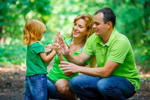 Portrait of Happy Family In Park Stock photo © luckyraccoon