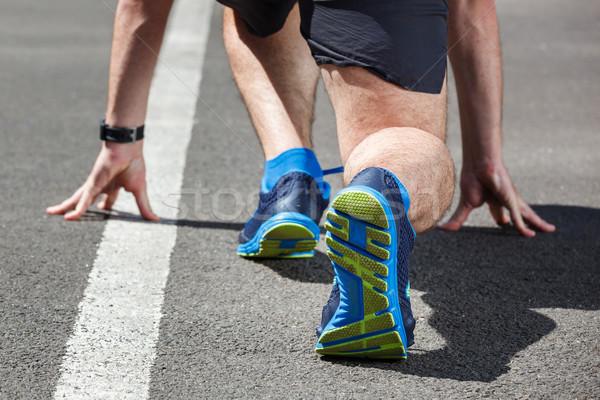 Corredor começar posição mãos estrada esportes Foto stock © luckyraccoon