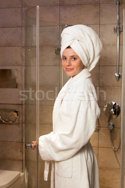 Young woman wearing a robe Stock photo © luckyraccoon
