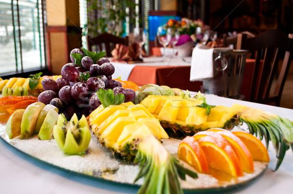 Gyümölcs mix narancs étterem asztal kék csoport Stock fotó © luckyraccoon