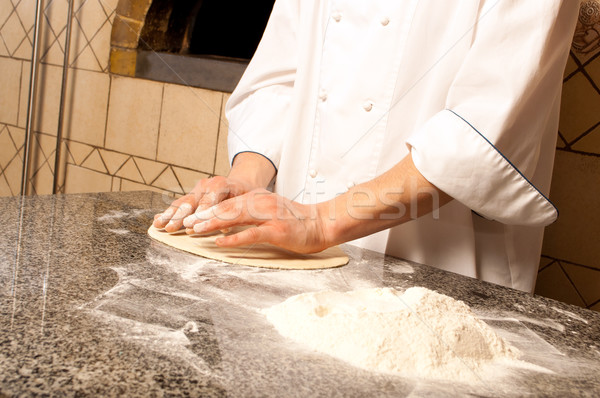 Chef making a Pizza Base Stock photo © luckyraccoon