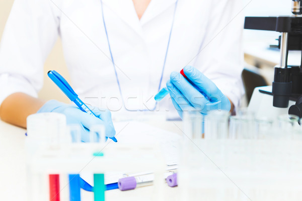 Scientist working with samples Stock photo © luckyraccoon