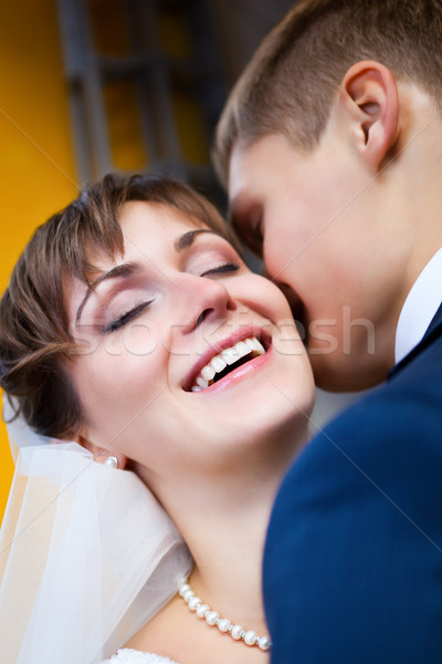 Bride smiling while groom telling her something Stock photo © luckyraccoon