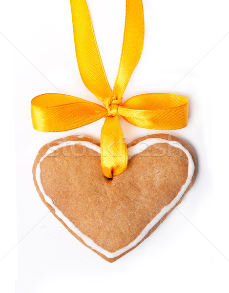 Ginger bread heart and yellow bow isolated on white background  Stock photo © luckyraccoon