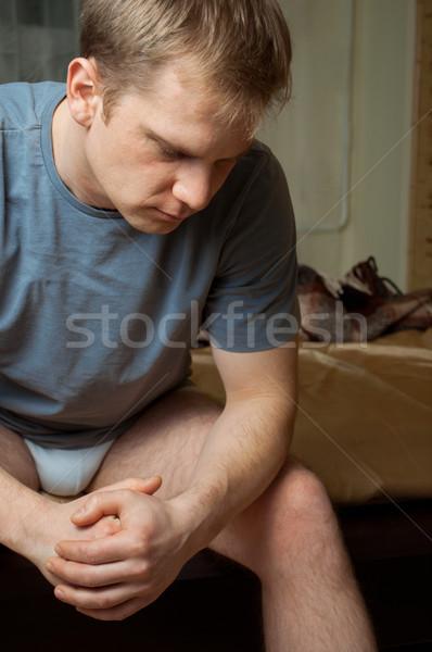 若い男 うつ病 座って ベッド モデル ホーム ストックフォト © luckyraccoon