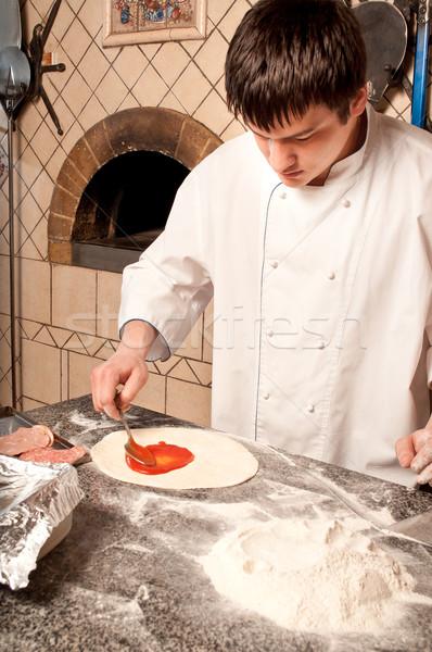 Chef making a Pizza Base Stock photo © luckyraccoon