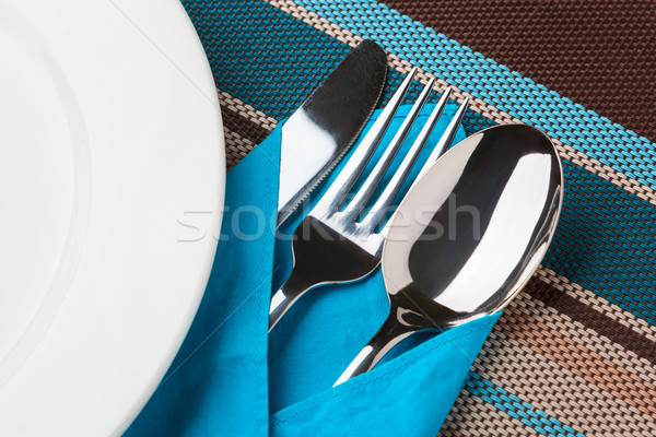 Stock photo: Knife, Fork, Spoon and plate on table.