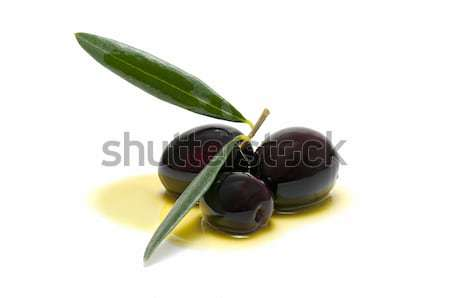 three fresh olives bathed in olive oil Stock photo © luiscar