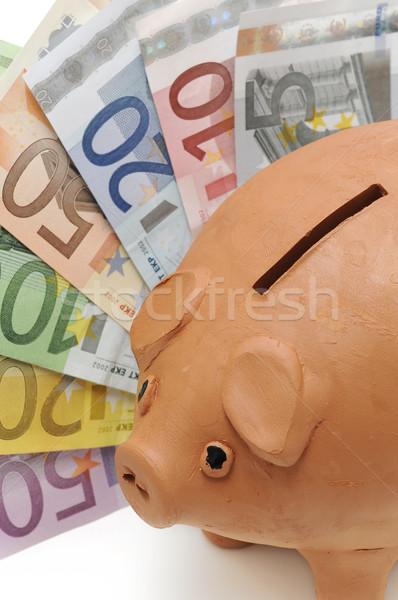 Piggy bank poupança euro notas branco negócio Foto stock © luiscar