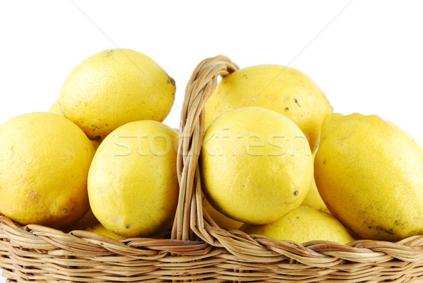 Close-up of lemons in a wicker basket on white Stock photo © luissantos84