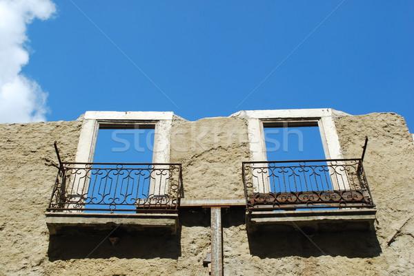 Damaged facade building (sky background) Stock photo © luissantos84