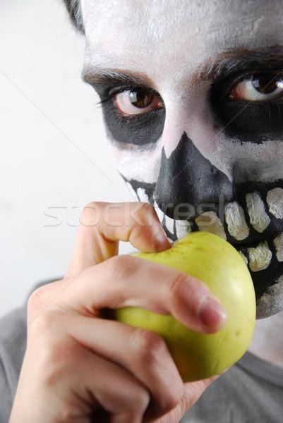 Mangiare mele scheletro ragazzo ritratto alimentare Foto d'archivio © luissantos84