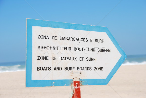 Boat and Surf sign at the beach Stock photo © luissantos84