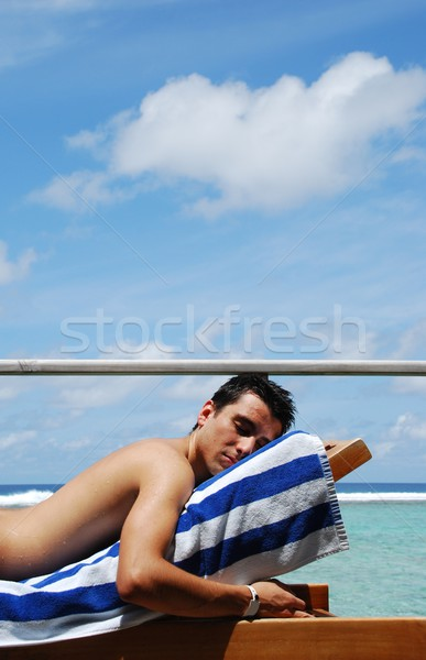Young man sunbathing in a Maldives resort room Stock photo © luissantos84
