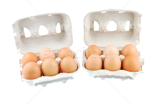 Twelve brown eggs packed in carton boxs Stock photo © luissantos84
