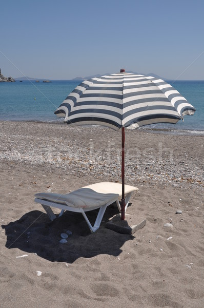 Ombrellone sedia magnifico spiaggia scena greco Foto d'archivio © luissantos84