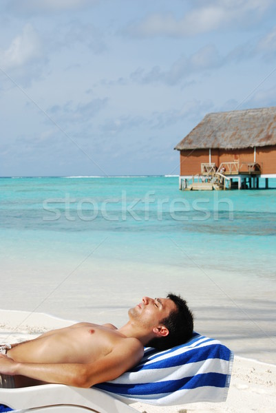 Young man sunbathing in a Maldivian Island beach Stock photo © luissantos84