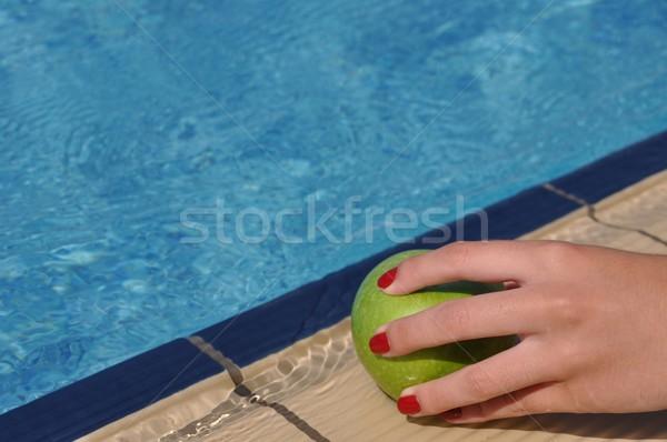 Woman holding apple Stock photo © luissantos84