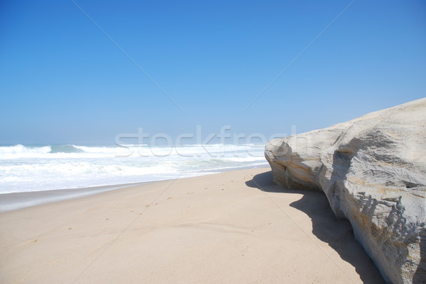 Small cliff at a beautiful beach in Praia del Rey Stock photo © luissantos84