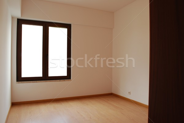 Empty and clean room with wooden floor Stock photo © luissantos84