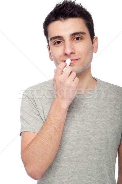 Moço lábio bálsamo bonito isolado Foto stock © luissantos84