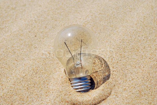 Lightbulb on sand (global warming) Stock photo © luissantos84
