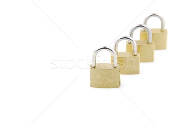 Golden closed padlocks on white Stock photo © luissantos84