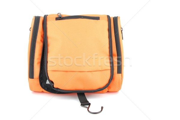 Stock photo: Orange toiletry bag