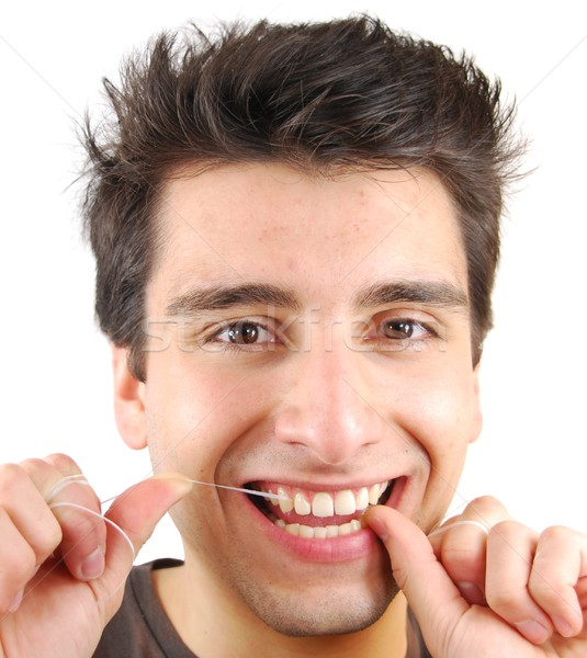 Man flossing his teeth Stock photo © luissantos84