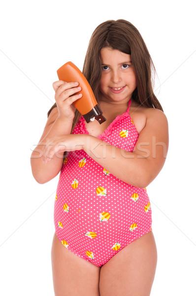 Girl in swimsuit applying sun lotion Stock photo © luissantos84