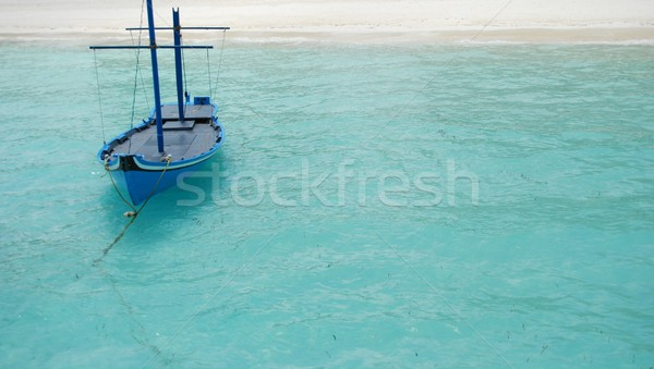 Typical Maldivian boat on blue ocean Stock photo © luissantos84