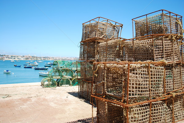 Old fishing cages in the port of Cascais, Portugal Stock photo © luissantos84